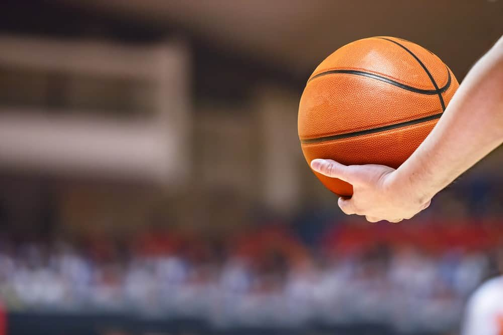 Grip the basketball with fingers only